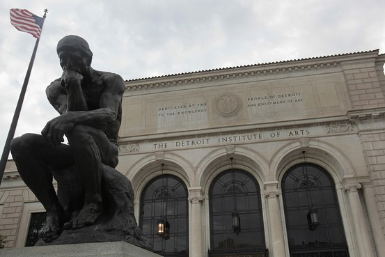 A statue of sculptor Aguste Rodin's 'The Thinker' is seen in front of the Detroit Institute of Arts museum along Woodward Avenue in Detroit, July 21, 2013.