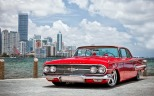 red-chevrolet-outside-city